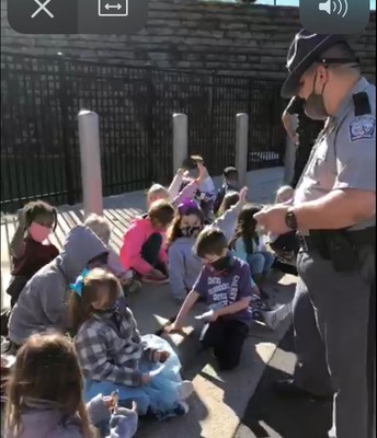 Police and Sheriff's Department Visit First Grade Outside