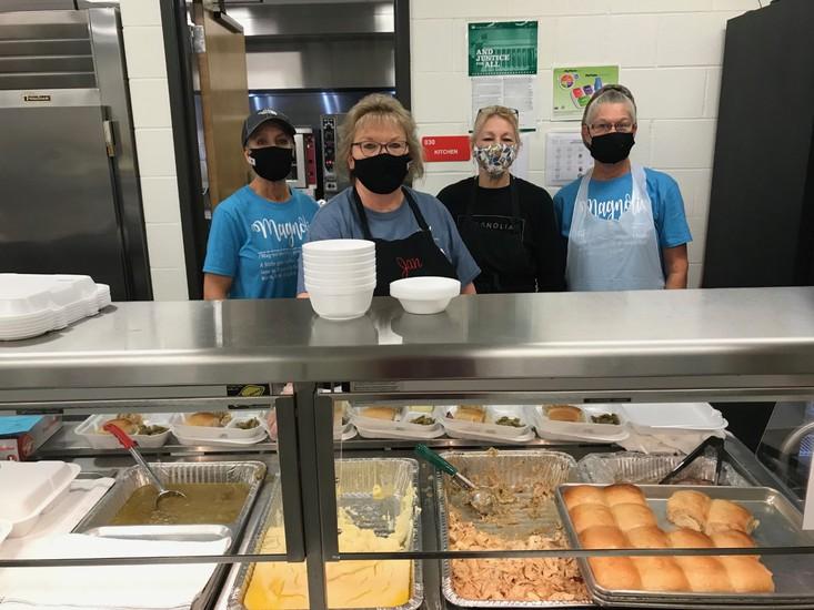 Magnolia lunchroom ladies on serving line