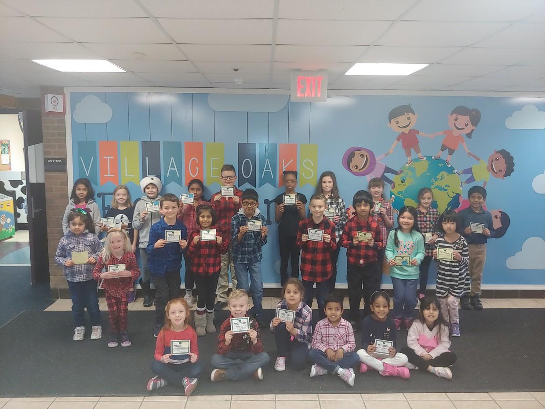 VO Students holding HEART Awards