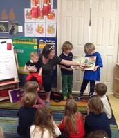 Tiffany reading to the class.