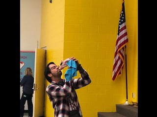 Mr. Davis Kisses a Pig