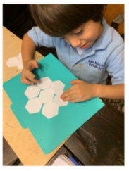 Kindergarten student, Nate, works with hexagons in math.