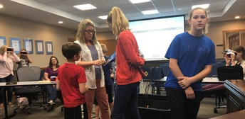 Mrs. Schwartze and her students teach the board about Virtual Reality
