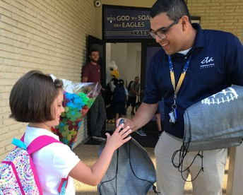 Pastors greet students on the first day of school