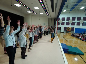 Staff performing during assembly