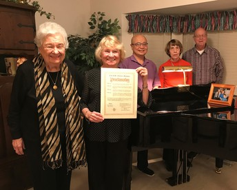 Members of Morning Etude displaying the Proclamation of American Music Month from Mayor Sally Faith of St. Charles
