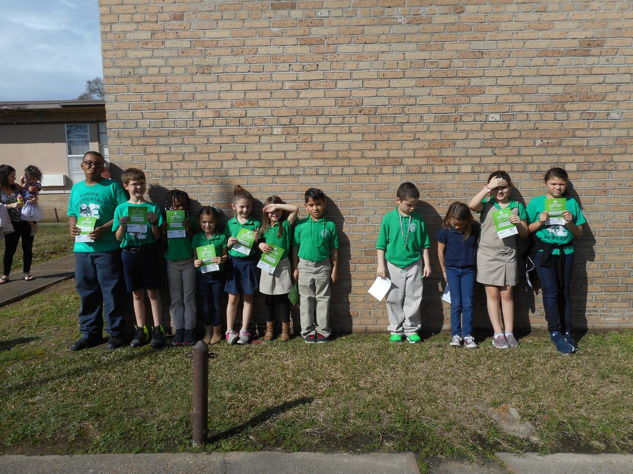 """At Eunice Elementary's flag pole ceremony, students were honored for their hard work in Accelerated Reading. Pictured in no particular order are Jah'naya Marshall, Addison Prejean, Kinzley Lejeune, Valerie Daigle, Juliana Godeau, Ian Rico, Gabe Collins, Kylie Rineheart, Christiana Jone Paul Guillory and """" Hayzen Eaves."""
