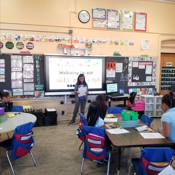 Gabriella telling the class about her summer.