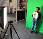 1st grade uses the green screen