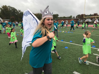 Kindergarten Teacher, Mrs. Burt is having fun at our Sharkathon Run
