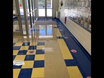 Markers in the hallway to help students know where to wait in bus lines