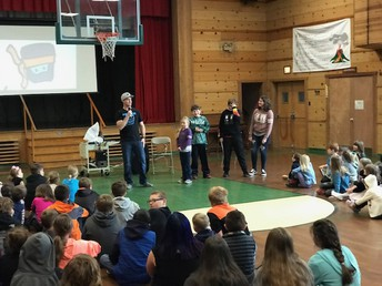 Brian Williams assembly with student volunteers on Friday, April 5