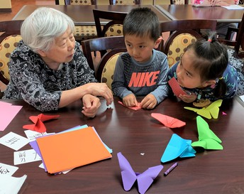 Sophia and Phillip Ma learn Origami with Greencastle residents!