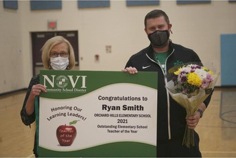 Pam Quitiquit and Ryan Smith with Outstanding Elementary Teacher Award