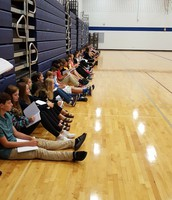 8th graders using gym observations for news stories