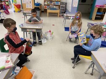 K students enjoying nonfiction reading