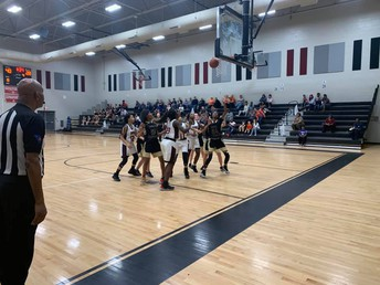 The girls basketball team defeated NAMS.