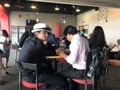 Students having conversation about future businesses