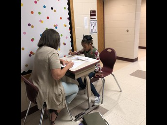 Mrs. Spaw working one on one with a student