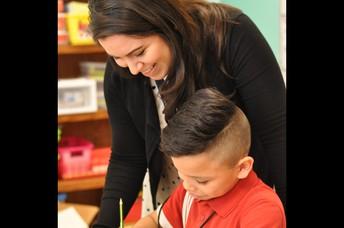 Mrs. Hopovac working with 2nd grade.