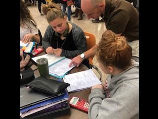 Mr. Clady Helping Two Bucks Work Through Algebra 1