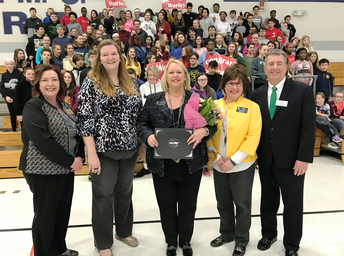 Dr. Worley Poses with FHSD Board President, Colleagues, & Students