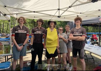 mountain bike team under hydration tent in Auburn posing for photo