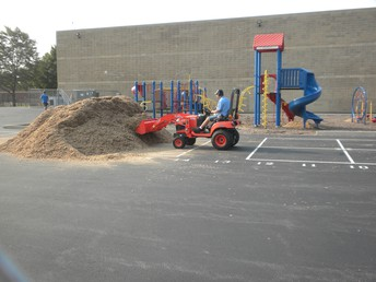 Boys taking care of the original playground with chips