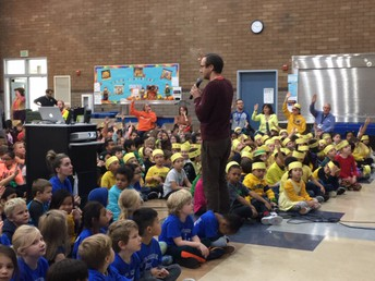 Kindergarteners in Blue and First Graders in Yellow during the Brilliant Bobcat Assembly.