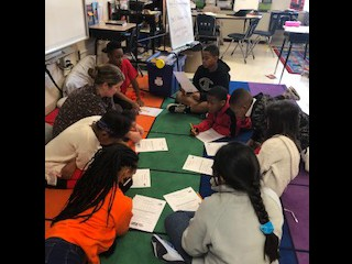 These 4th grade students were working our problems, discussing, and collaborating during their Guided Math time!