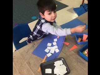 Building a snowman with shapes.