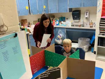 Mrs. Frisch helping a student to get organized