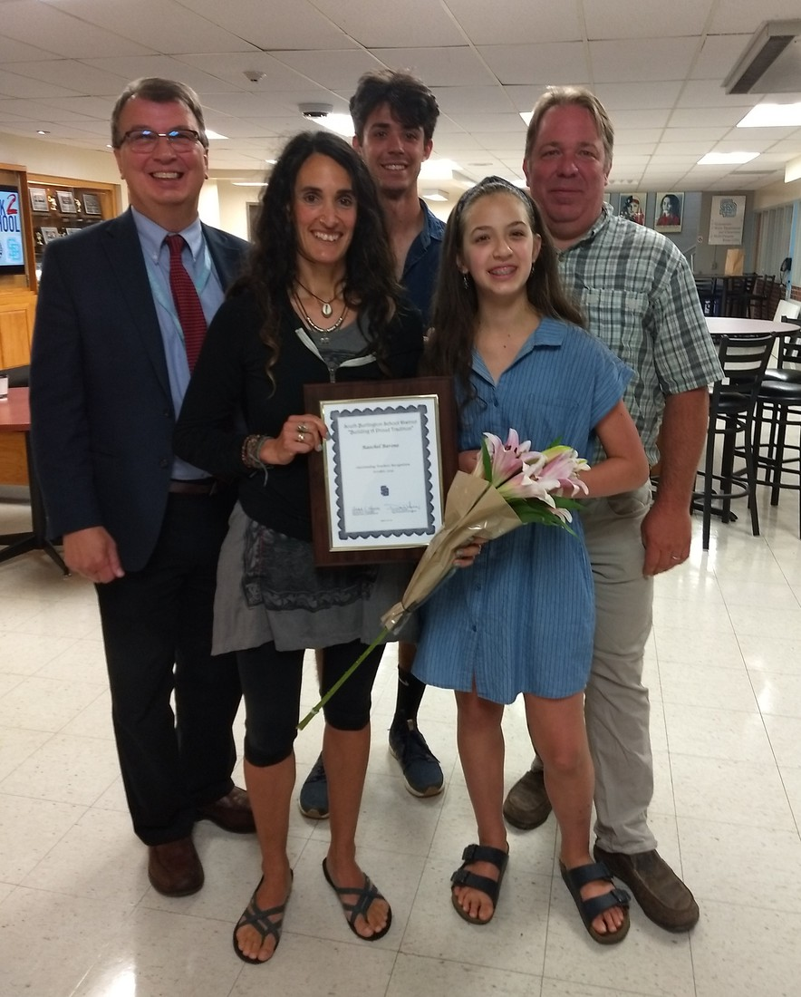 Raechel Barone acknowledged at the entire SBSD Convocation. Also in the photo is her family and Principal T.
