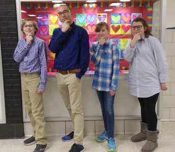 Mr. Hilston with students in matching bowties at Chardon Middle School.