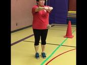 NYO teacher demonstrating the 2 foot kick