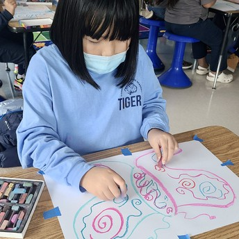 A student makes a symmetry drawing of a butterfly.