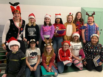 5th Graders with Festive Hats and Socks!