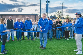 Board President Mark White Cuts the Ribbon