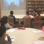 Students Skyping with an author