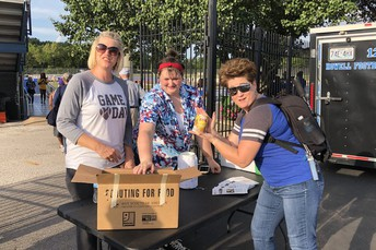 $1,150 & 500 Cans Donated at Football Jamboree For Oasis Food Pantry