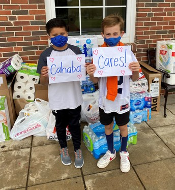Students holding sign Cahaba Cares