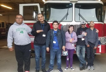 Transitions academy posing in front of a fire truck during a career exploration to the station.