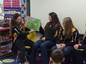 Varsity Girls Softball reads to class