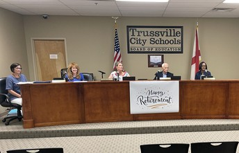 Trussville Board of Education members, Sandra Vernon (executive asst to the Superintendent), and Superintendent Dr. Pattie Neill seated at dais