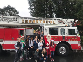 Getting ready to head out to deliver gifts on the firetruck!