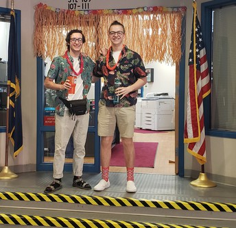 Jared and Anthony, two of our recess staff supervisors, Dress up for Tropical Island Day