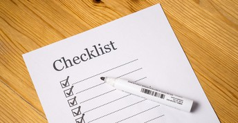 Checklist with boxes and pen
