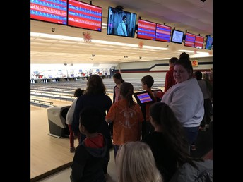 High School Student Council Members helped bowlers mangage their lane
