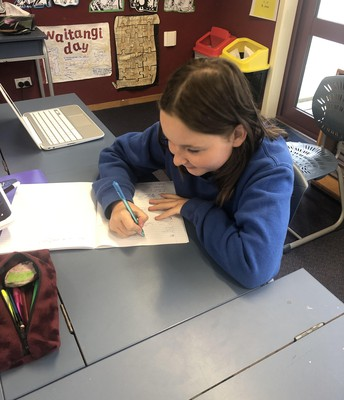 Ruby M writing her persuasive article!