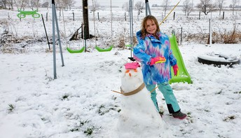 Mrs. Mikel's daughter and her snowman! Very cute!